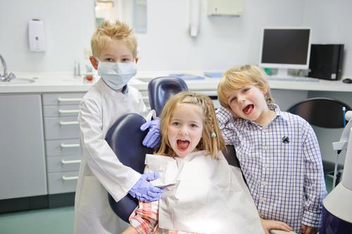 three kids at the dental office